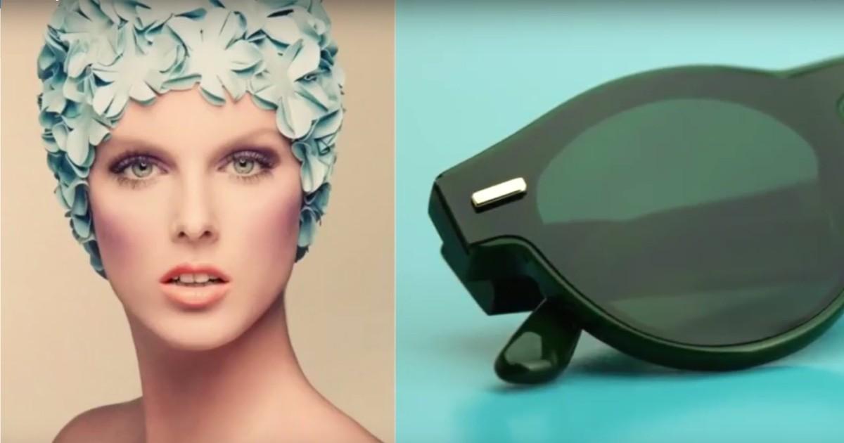 Woman in swim cap and black sunglasses